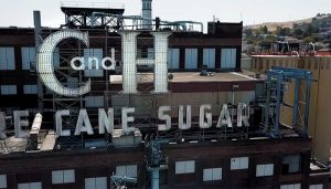C&H Sugar Factory Sign and Brick Building with Two Silos
