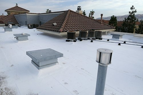 White Acrylic Roof in San Jose with tile roof.