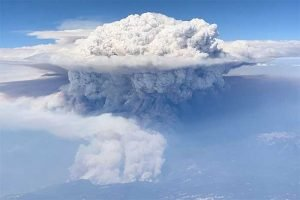 Large clouds of ash and steam forms pyrocumulus cloud above Sierra Nevadas