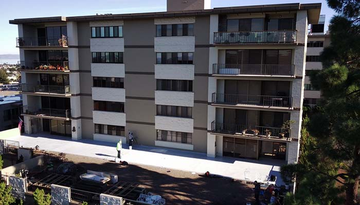 Deck waterproofing at the Mounds in San Mateo, CA.